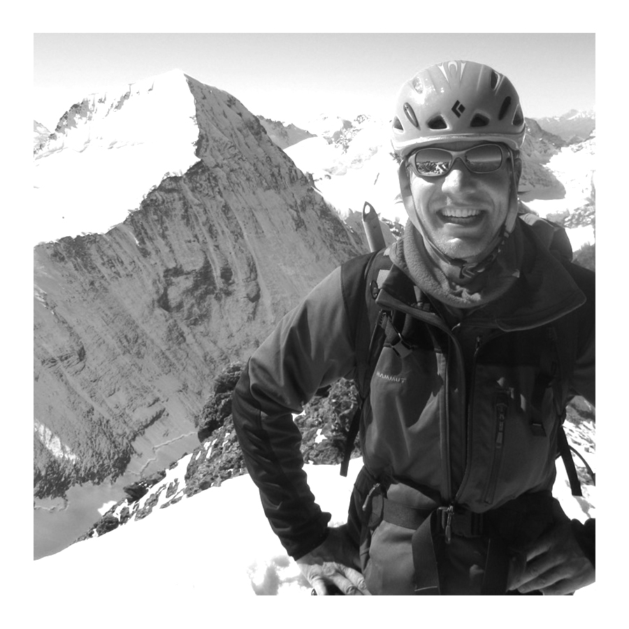 Original photograph of climber reaching the summit of the Eiger